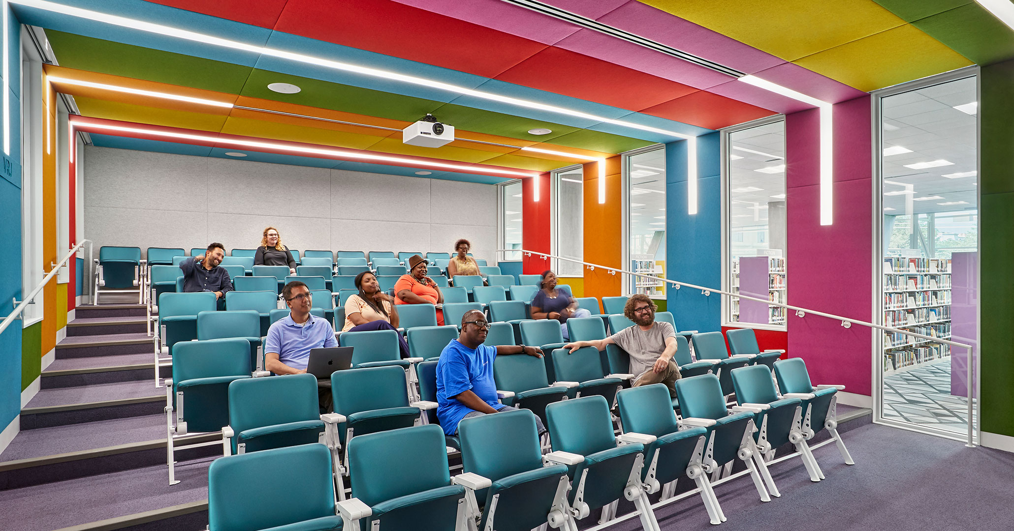 Richland County Library worked with Boudreaux architects to design colorful stadium seating theater for Richland Libraries.